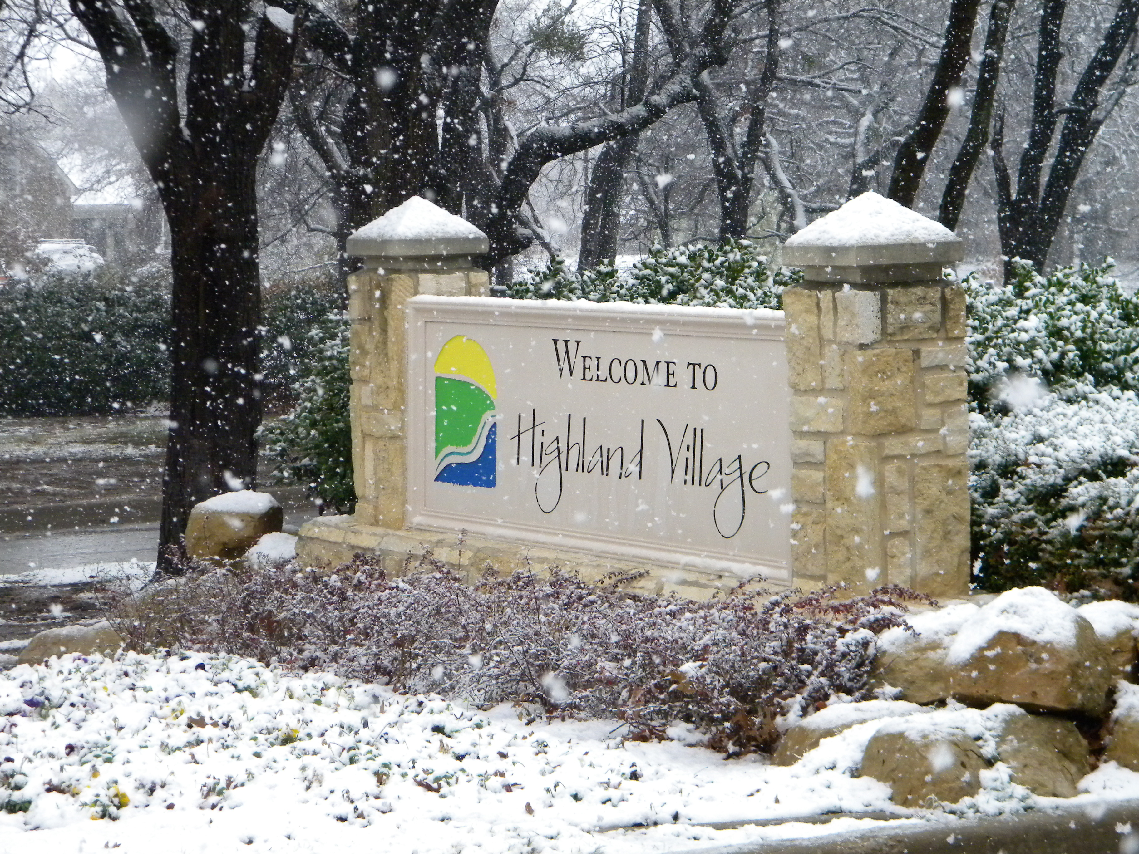 Highland Village sign in the snow